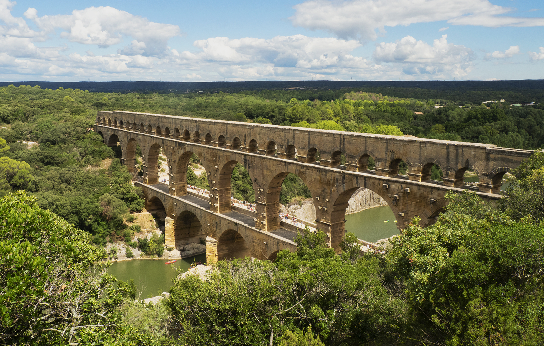 Pont du Gard is an ancient Roman aqueduct in Provence, France. Easy daytrip from Avignon for exploring the Roman ruins, swimming, picnicking, kayaking or just relaxing.