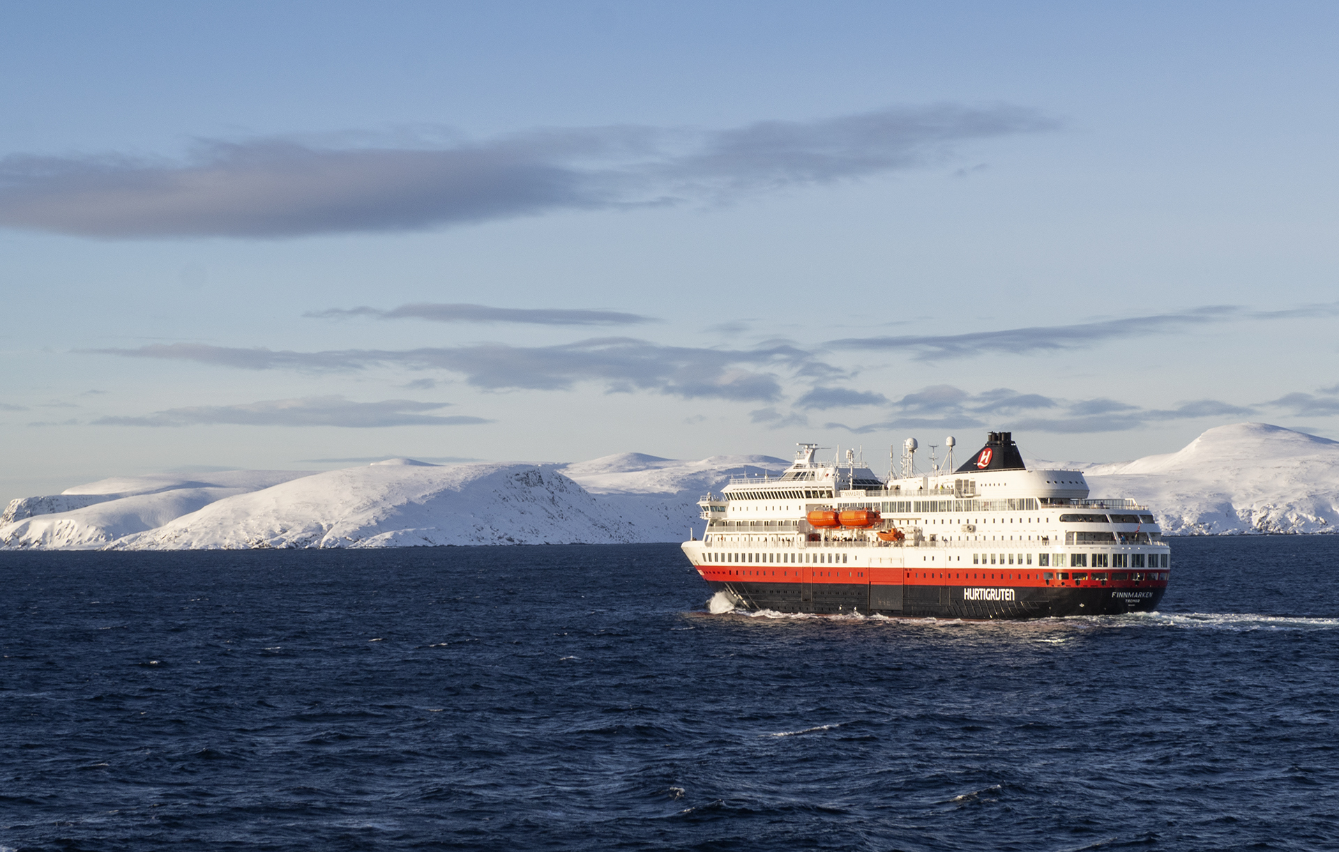Explore the coast of Norway on a Hurtigruten ship. Great solo travel option to discover this unique adventure in Norway.