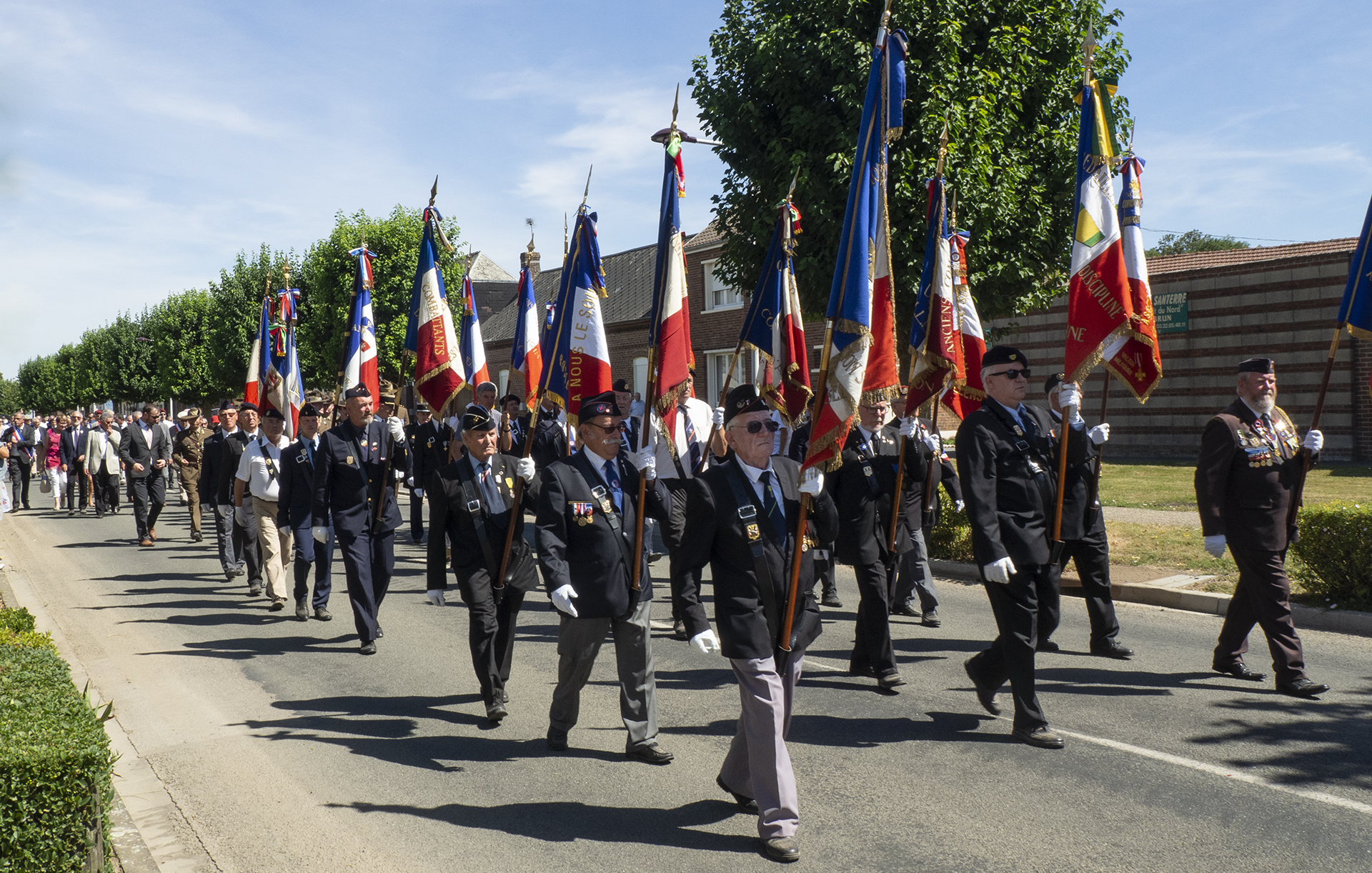 Parade through the village of Harbonnières to the next event of the day.