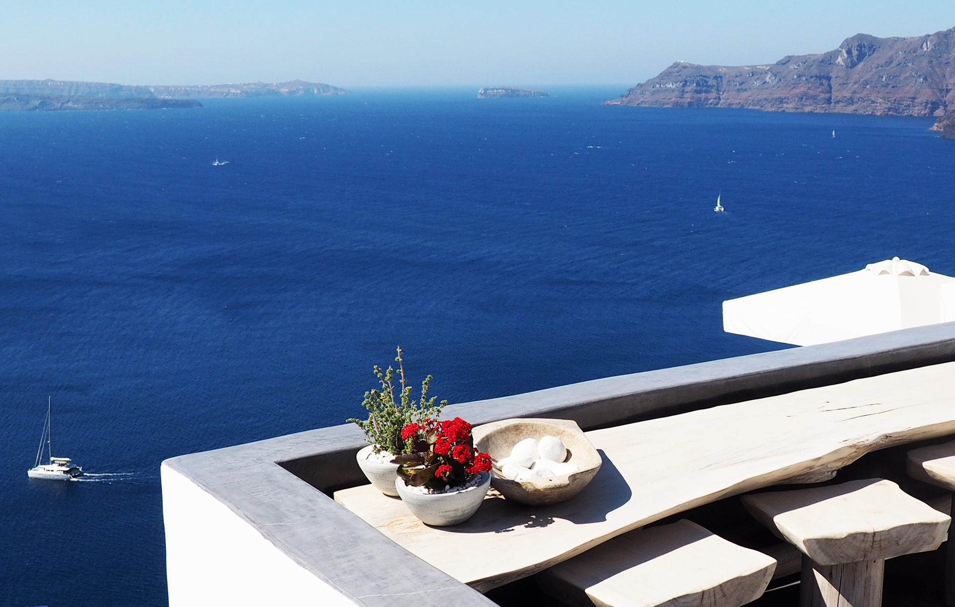Hot summer day, view of the blue water and sky of Santorini's caldera from Oia