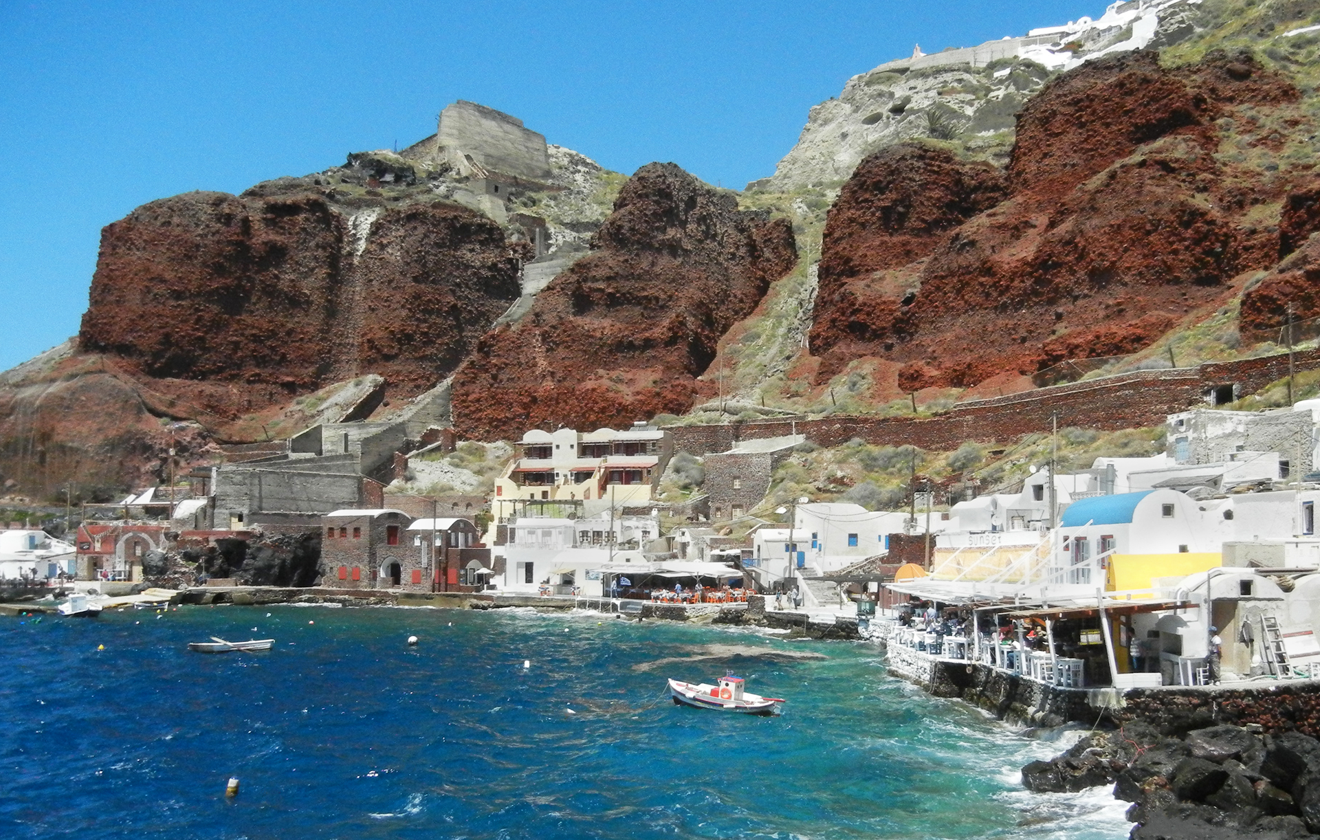 Below the cliffs of Oia on Santorini is the quaint village and harbour of Ammoudi Bay
