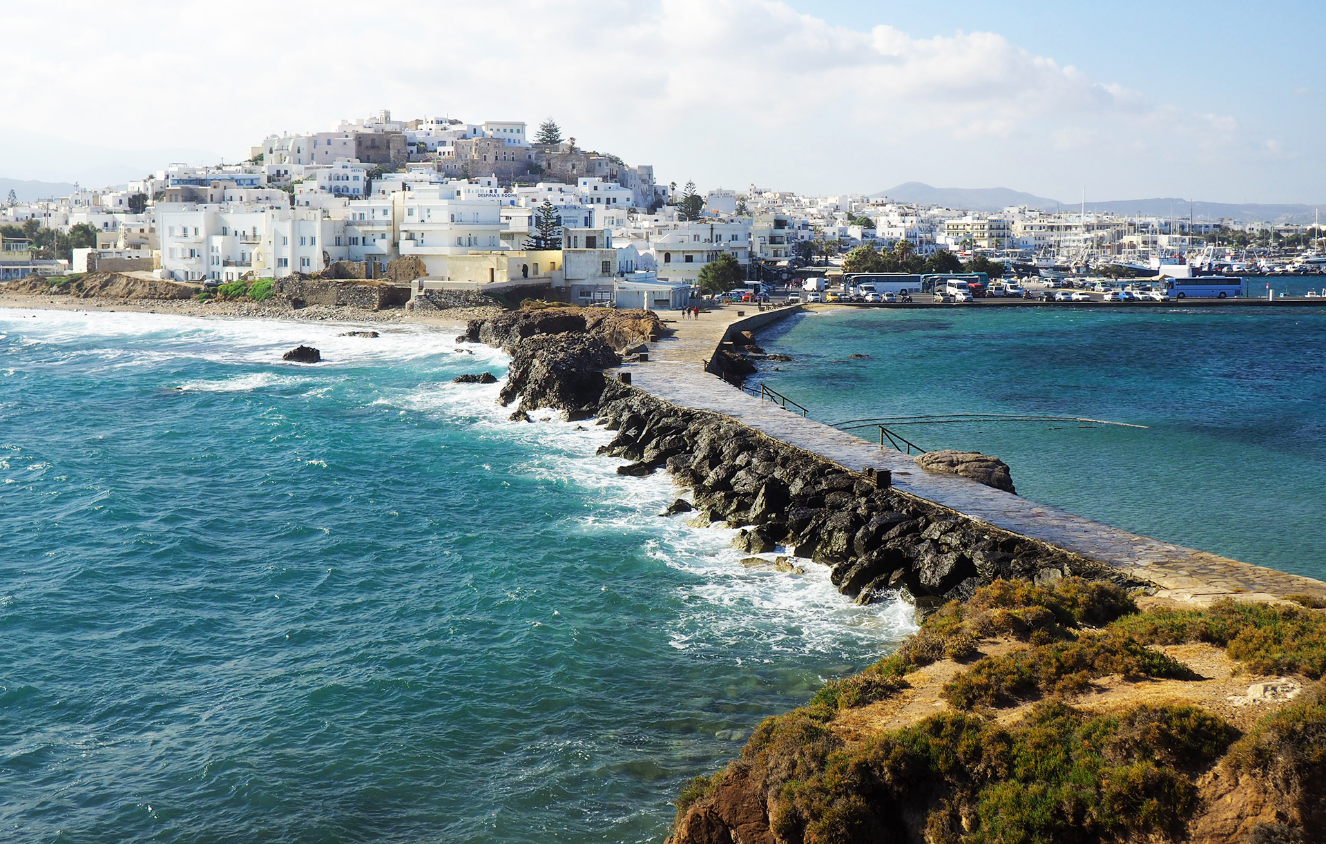 Greek Island Destination - Naxos Island, the manmade causeway and breakwater from Naxos town to the Portara