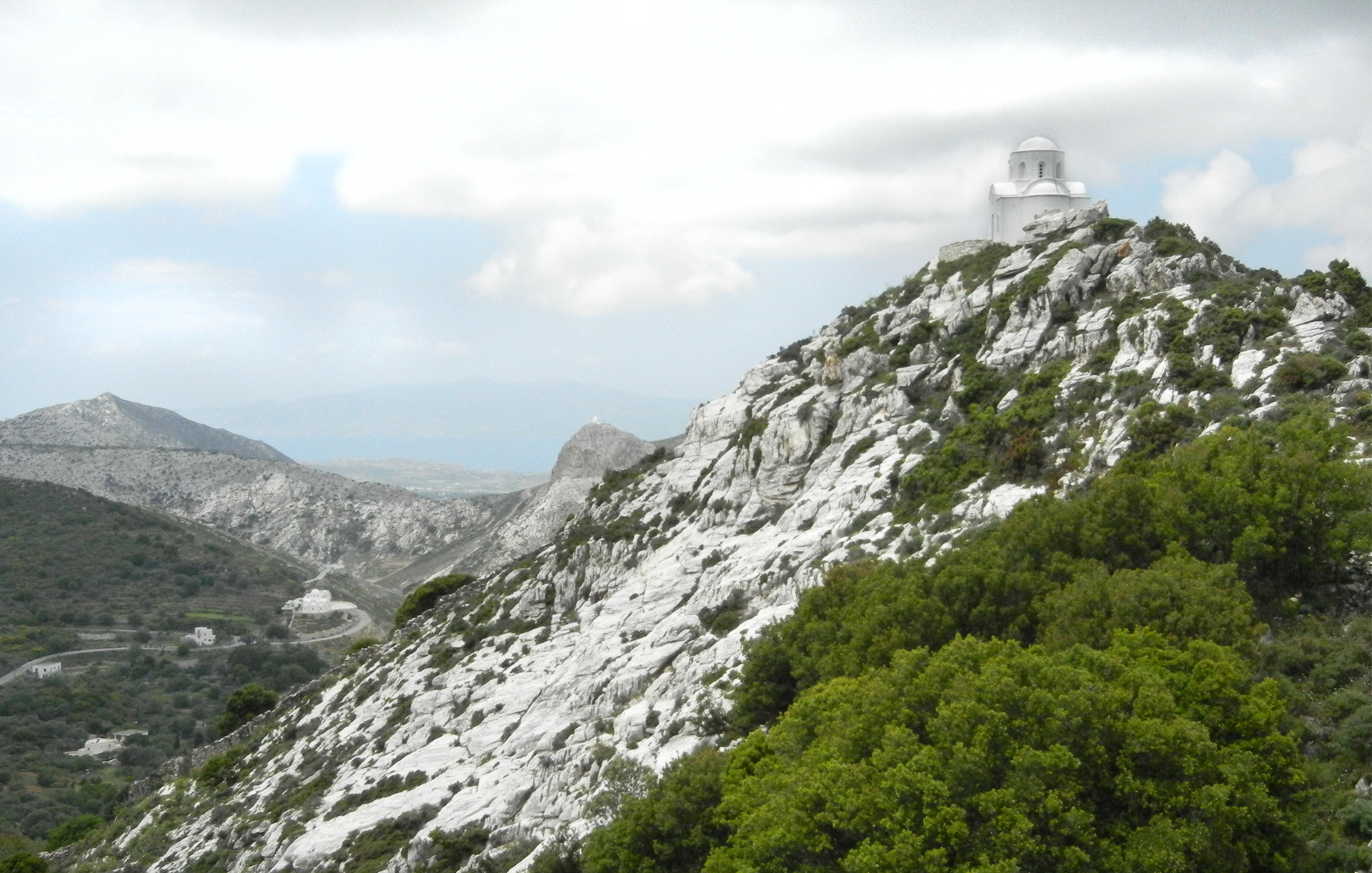 Mountains and valleys of Naxos Island. Each mountain topped with a traditional Greek Orthodox church