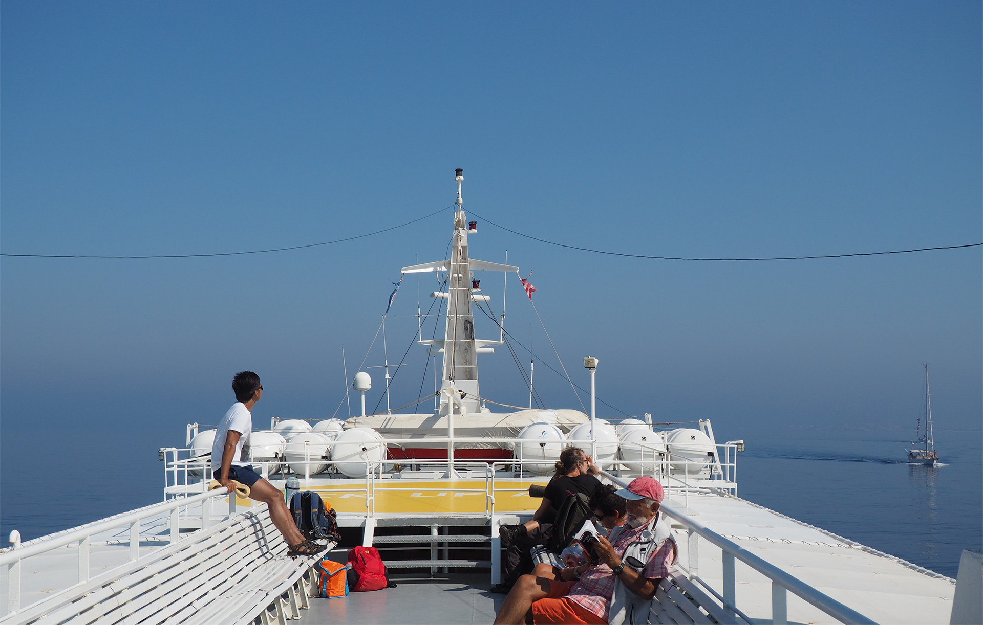 Old fashioned Skopelitis ferry, from Naxos to Koufonisia. Calm sea and sky melt together on a hot summer day.
