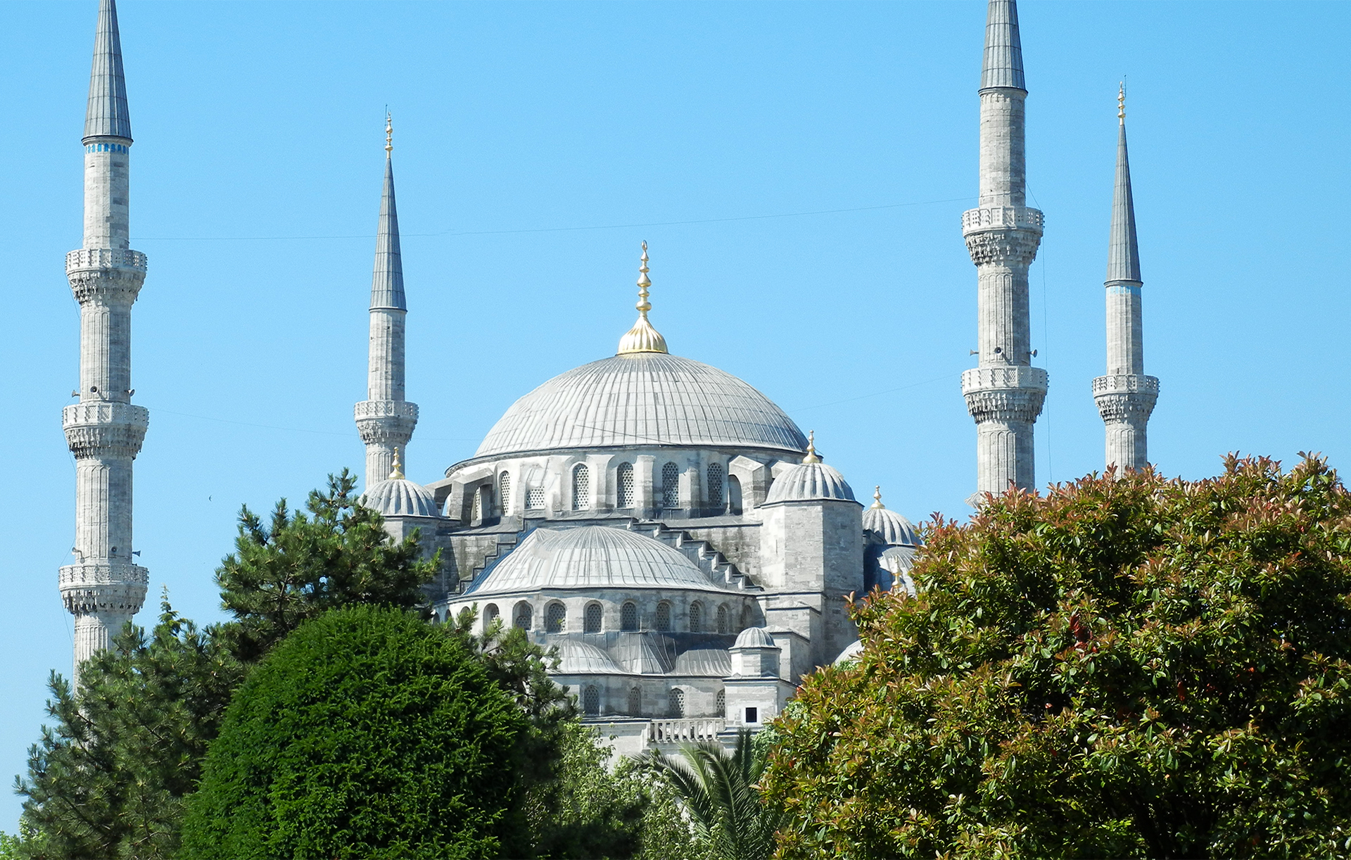 The Blue Mosque in Istanbul with four of it's six minarets against the clear blue sky