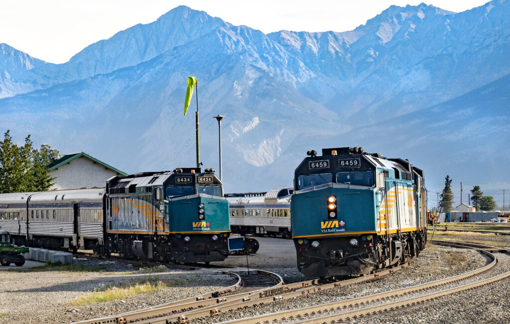 The Vancouver to Jasper Train. Two VIA Rail Trains waiting in Jasper for departure with the Canadian Rockies in the background