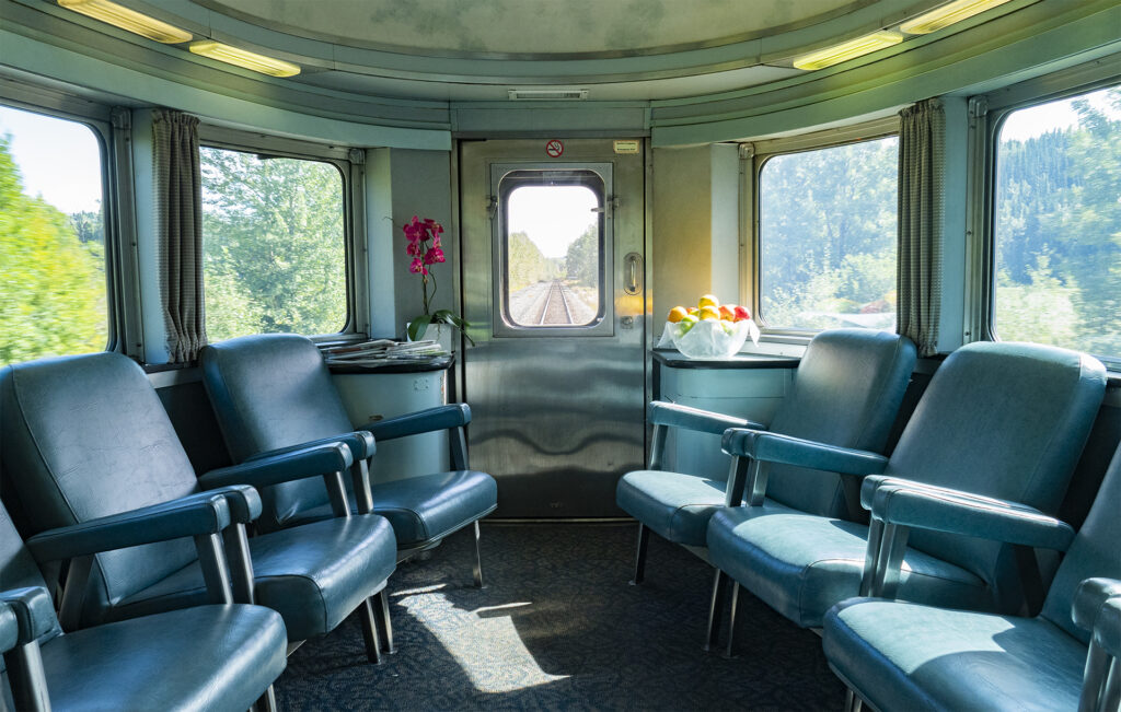Interior view of VIA Rail's Park Car, this one is not restored but is a classic beauty with lots of windows and the view directly out the back of the train
