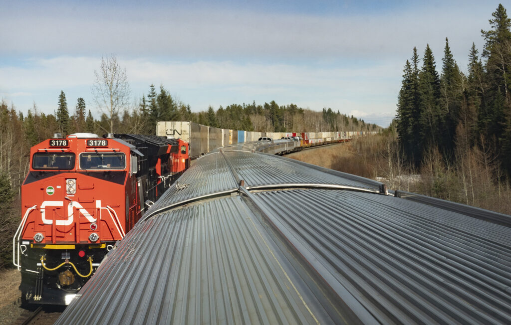 VIA Rail's passenger train on the right track and CN's freight train on the left track