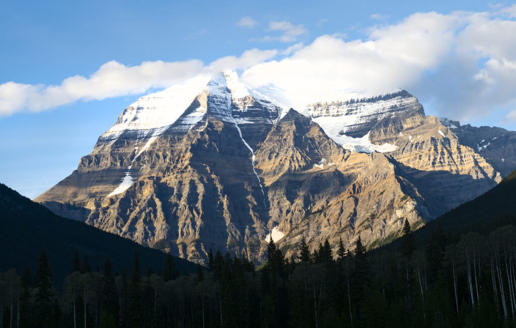 The majesty of Mount Robson with it's peak covered with a few clouds. Another beautiful view from VIA Rail's Canadian