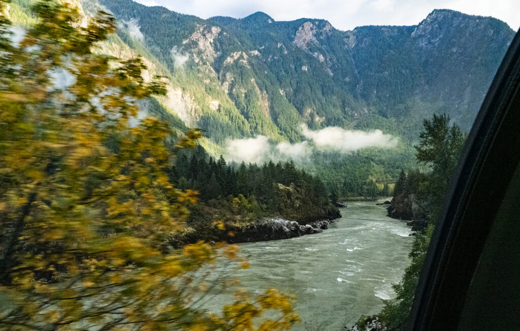 Captured the movement from the train, fall coloured trees, the mighty Fraser River and the rising mountains alongside the Fraser Canyon